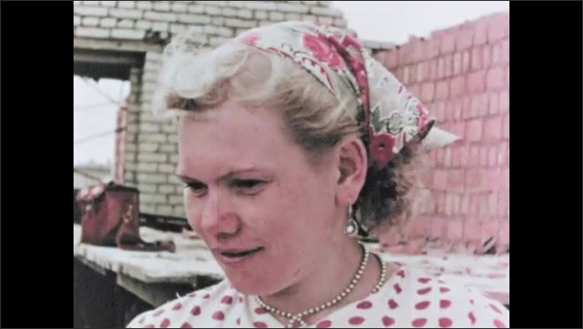 RUSSIA 1960s: workers build house from bricks. Man builds wall. Close up of woman on building site.