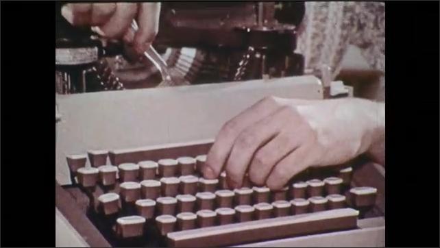 1970s: UNITED STATES: lady takes cover off typewriter. Book keeper at work. Man repairs typewriter. Office machine operator