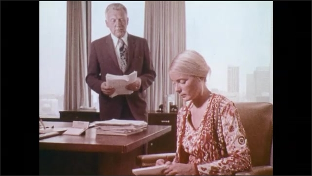 1970s: UNITED STATES: lady types in office. Lady drops notes at desk. Hand dictates notes. Accounting clerk looks through book
