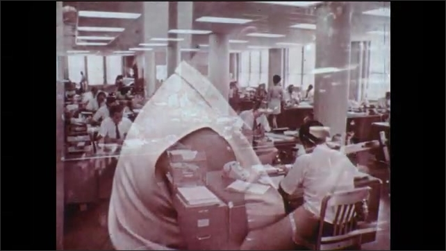 1970s: Men work with electronic devices. Man with petri dish. Man in tie. Boardroom presentation. Office clerks at work. Electronic manufacturing plant workers.