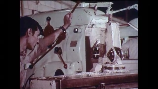 1970s: Man lifts large object. Man uses drill to shape metal. Men stand among machines. Man reads paper. Man measures object with calipers. Man uses machine to press sheet metal. Man blows glass.