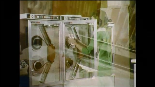 1970s: Large computer equipment. Woman changes tape in equipment. Woman controls file stacks. Woman walks down street.