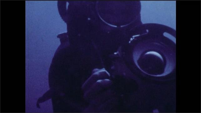 1970s: Construction crane. Man operates oscilloscope. Woman speaks into radio. Men work on map. Scuba diver adjusts camera. Men on ship lower probe into sea. Nuclear scientists. Teacher at blackboard.