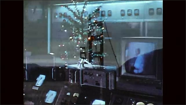 1970s: TV monitors on station panel. Golden Gate Bridge, city skyscrapers.