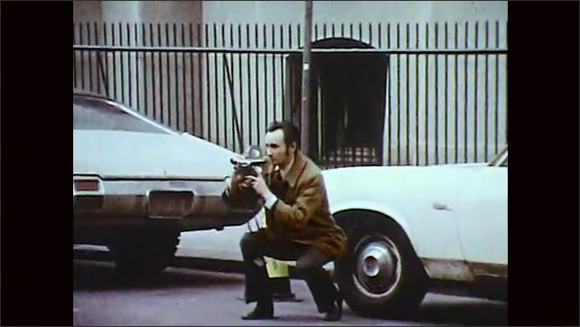 1970s: Advertisement agents discuss idea board at desk. Man exits news car, crouches in street, camera ready. Weatherman adjusts forecast set. Lady adjusts woman