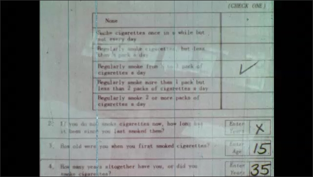 1960s: Questionnaire with check marks, numbers and handwriting. Woman types on cards using tabulator machine.