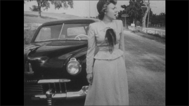 1950s: Young woman exits car and looks frustrated. Young woman walks up to car and bickers with other woman through window.