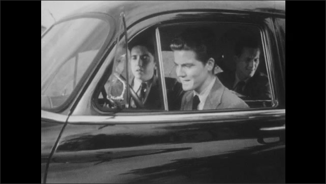 1950s: Three young men in stalled car. Driver is extremely frustrated at being out of gas. Backseat passenger exits car as driver gets angry.