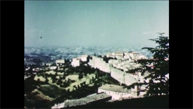 1950s: ITALY: EUROPE: view across valley. City built on hill. Medieval village. Wall around ancient village