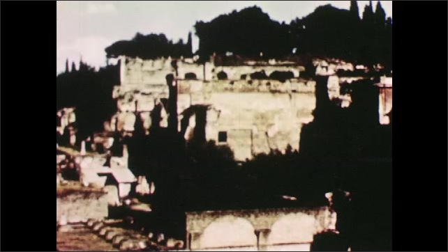 1950s: ITALY: EUROPE: ancient buildings in Italy. Ancient Roman forum.