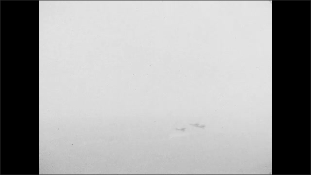 1920s: Flying over river in biplane. Other planes in flight. Flying over river. Flying over ground.