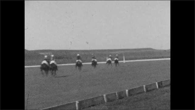 1920s: People on horses play polo on field.