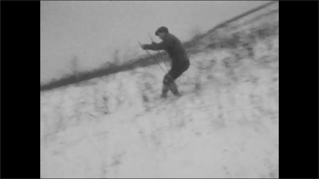 1920s: Person skiing, tumbles down bushy, snowy hill. Person tries skiing down hill and falls. Person crashes while skiing down hill.