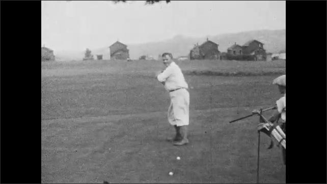 1920s: Men play golf.