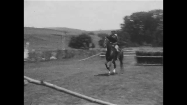 1920s: Man rides horse up to hurdle on obstacle, race course and stops. Man rides horse up to hurdle and stops. Man rides horse up to hurdle and stops. Man jumps hurdles on horse.