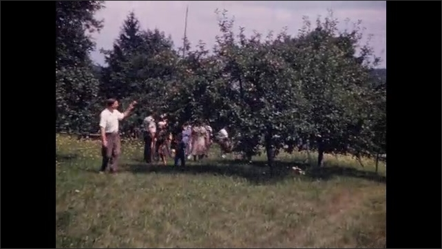 1940s: Man handles tiny salamander; large family group walks amid orchard trees; shirtless boy in sailor cap waves.