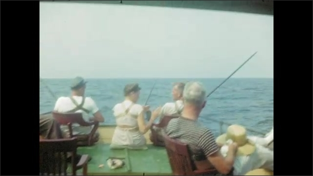 1940's: Tourists strapped into chairs fish from back of fishing boat; woman sleeps in back of boat as boat tosses on waves.