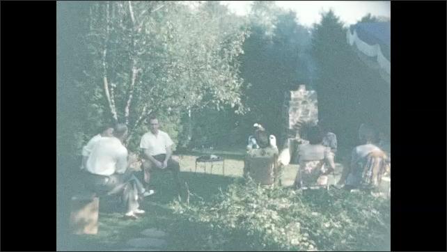 1940s: Men work in vegetable garden; man adjusts steaks on outdoor grill.