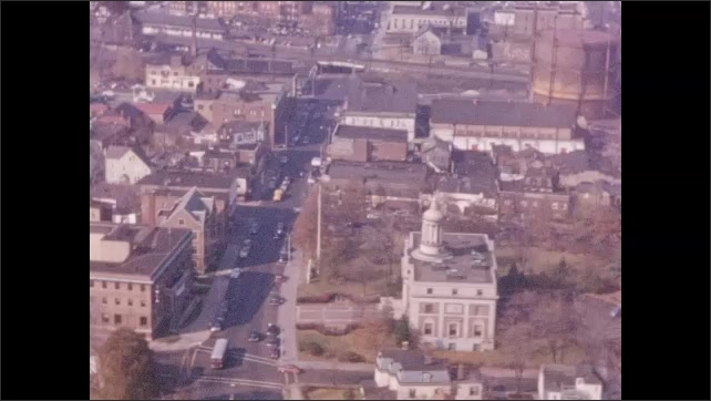 1950's: Aerial views of Plainfield New Jersey; cars drive past City Hall.