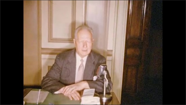 1950's: Series of men in suits sitting at desks and speaking into microphone.