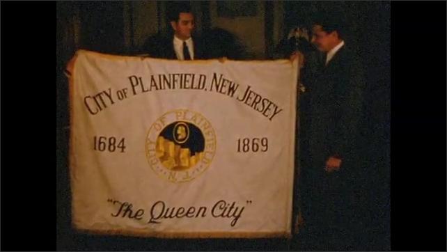"1950's: Three men display ""City of Plainfield"" banner."