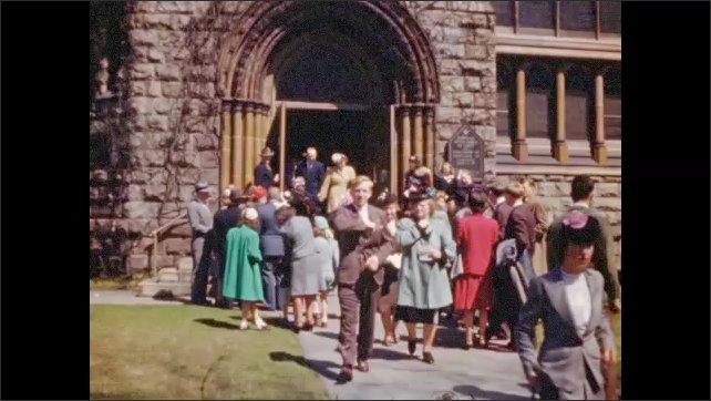 1950's: Exteriors of Messiah Lutheran Church; churchgoers stream out of church door wearing Sunday clothing.