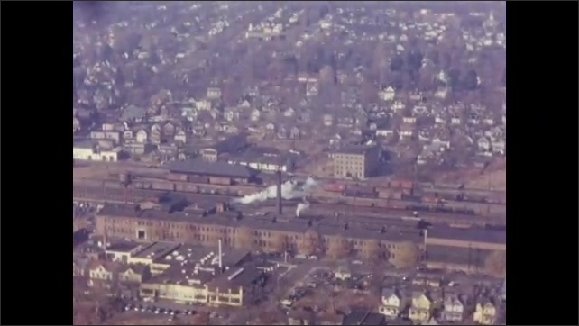 """1950's: Aerial views of Plainfield New Jersey factories, industrial areas, row houses; water tower reads """"Wood Newspaper Machinery Corp."""""""