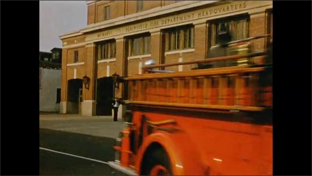 1950's: Plainfield Fire Department truck with 'Mack Truck' logo; fire trucks roar out of Fire Department garage; officer speaks on telephone.