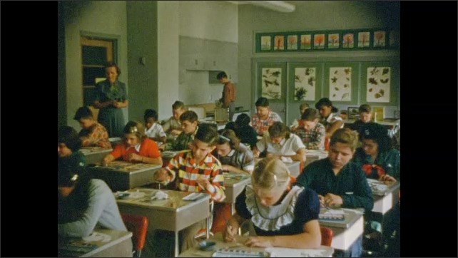 1950's: Children play on indoor teeter-totter; students work at watercolor painting at their desks.