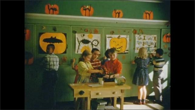 1950's: Teacher instructs school children; children work at bulletin boards; children line up in school yard.