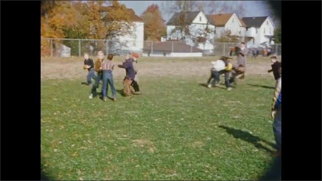 1950's: Boys play football in school yard; student operates drill press.