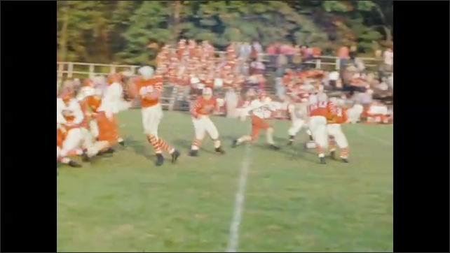 1950's: High school football players make several plays.