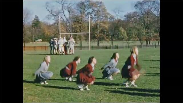 1950's: High school athletes play football; cheerleaders perform routine.