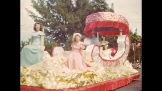 1940s: Marching band parades down crowd-lined street; colorful floats with beauty queens in elaborate costumes.