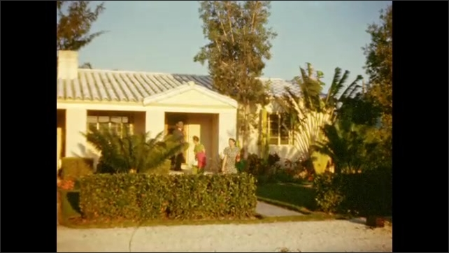 1940s: Man and two women emerge from small Florida vacation home.