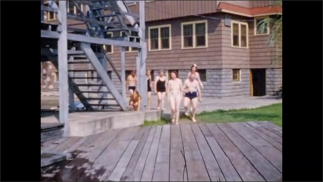1940s: Williams Lake Resort viewed form lake; swimmers walking past staircase tower onto pier.