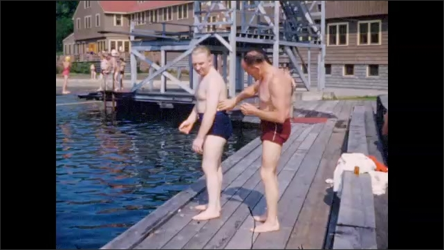 1940s: Two men prepare for swimming on pier at Williams Lake Resort.