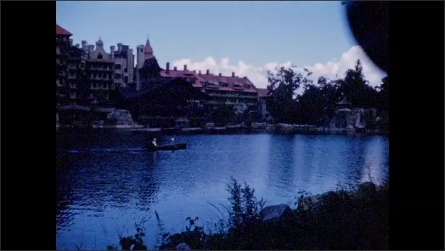 1940s: Horse-drawn wagon rolls along driveway; rowboat on resort pond at sunset; people stroll among colorful flower beds.