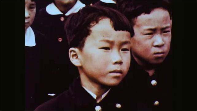 1960s: Man boys. Children standing in rows bow back. Boy. Girl. Boy. Boy. Boy. Girl. Girl.