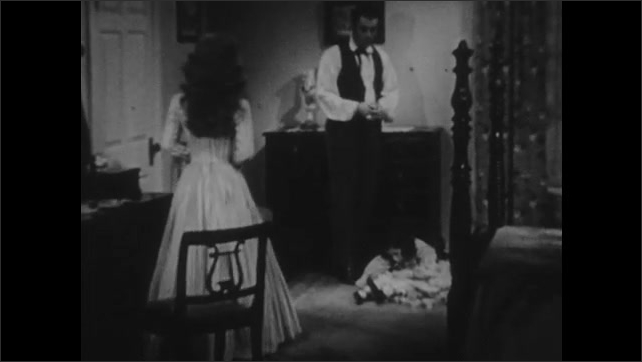 1940s: Man and woman talking, man walks away. Couple in room with girl, man walks to dresser. Woman talks to man.