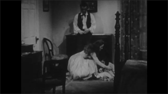 1940s: Man and woman talking, woman turns away. Woman picks up girl, exits room.