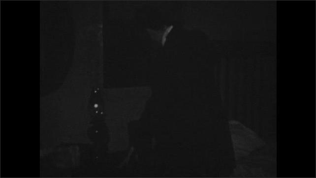 1940s: Man enters room, lights lamp.