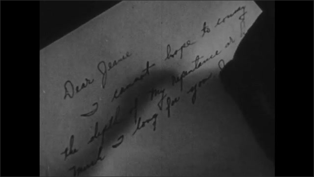 1940s: Close up, hand writing letter.