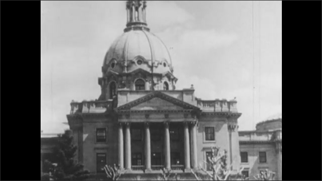 1950s: Soldiers on horses gather around flag. Exterior of courthouse. Men and woman in courtroom.