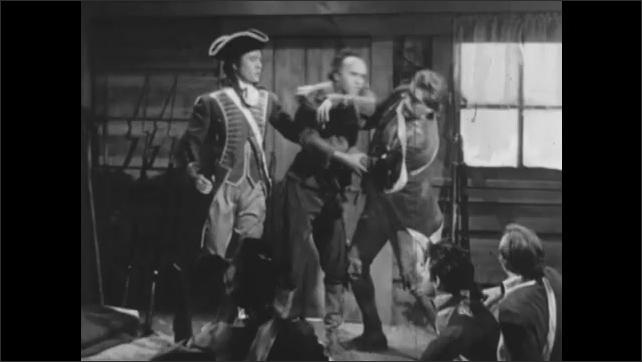 1950s: Boy stands in field. Men in uniform argue. Man breaks up argument. Men talk.