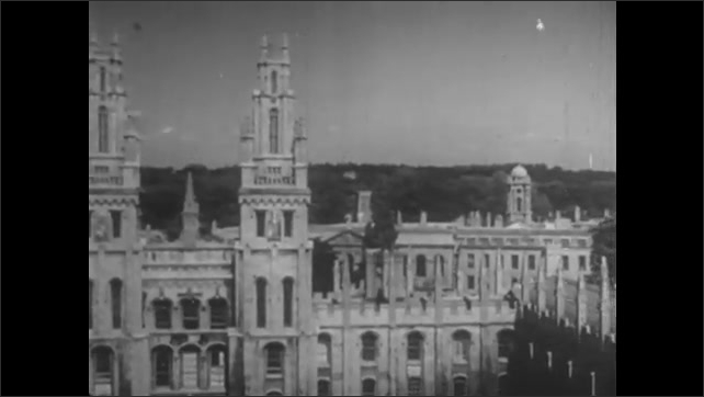 1950s: UNITED STATES: men talk on stairs. Men laugh together. Buildings in Oxford. Cloisters in Oxford.