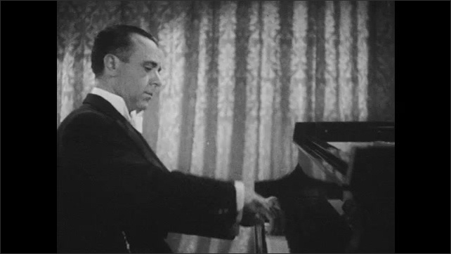 1940s: Jose Iturbi's hands play piano, hands are reflected in piano front above keyboard, Iturbi plays piano seen from side, playing ends