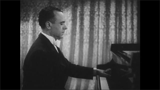 1940s Jose Iturbi faces camera and talks, introducing a Chopin piano work, Iturbi plays piano