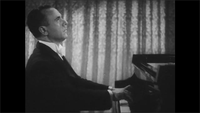1940s: Jose Iturbi plays piano, seen from the side