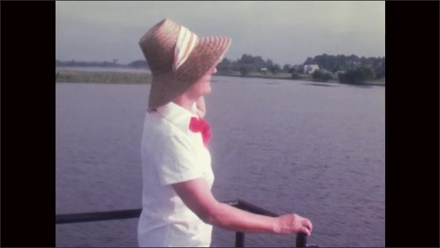 1970s: KNOTTS ISLAND: UNITED STATES: lady on ferry to Knotts Island. Car on ferry.
